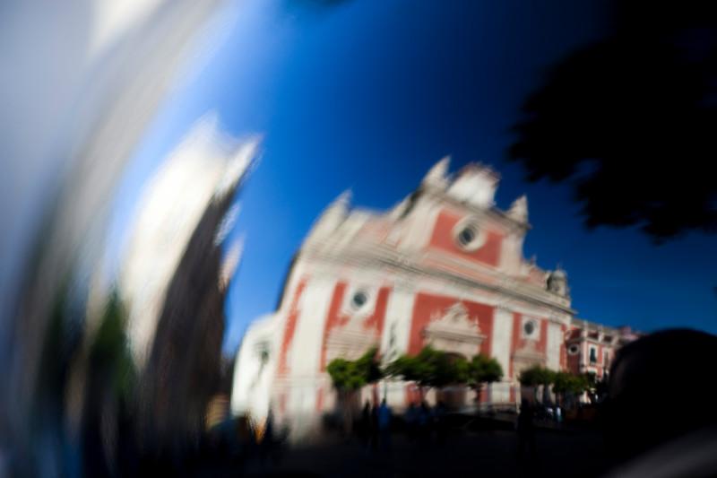 El Salvador church reflected on a crash helmet, Seville, Spain