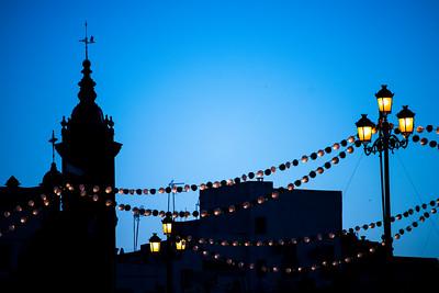 Paper lanterns on the Triana bridge for the Vela de Santa Ana festival, Seville, Spain