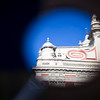 El Salvador church reflected on a motorcycle rear mirror, Seville, Spain