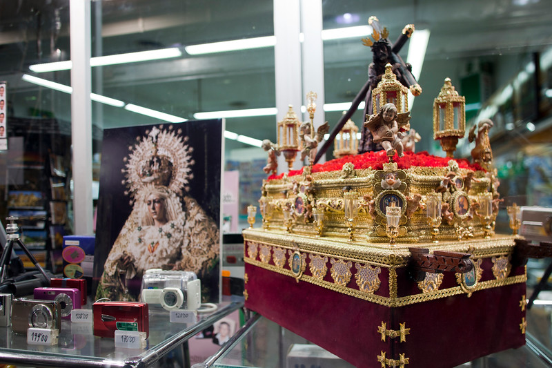 Holy Week miniatures and pictures on a shop window, Seville, Spain