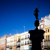 Fountain with a statue of Mercury, San Francisco square, Seville, Spain. Tilted lens used for shallower depth of field.