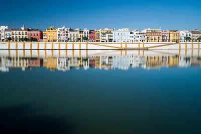 Betis street reflected on the Guadalquivir river, Seville, Spain