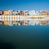 Betis street reflected on the Guadalquivir river, Seville, Spain
