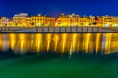 Betis street by the Guadalquivir river at night, Seville, Spain.