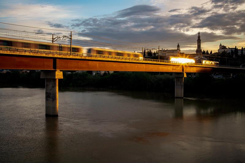 Metro de Sevilla (Undeground) train over the Guadalquivir river, San Juan de Aznalfarache, Seville, Spain. Composite image out of a burst of four frames.