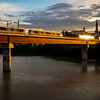 Metro de Sevilla (Undeground) train over the Guadalquivir river, San Juan de Aznalfarache, Seville, Spain. Composite image out of a burst of four frames.