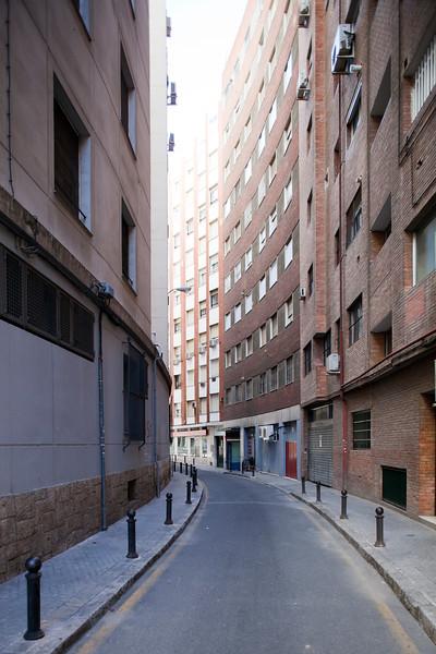 Lane between high-rise buildings, Seville, Spain