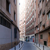Lane between high-rise buildings, Seville, Spain