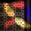 Colorful reflections from a stained glass window, San Lorenzo church, town of Seville, autonomous community of Andalusia, southern Spain