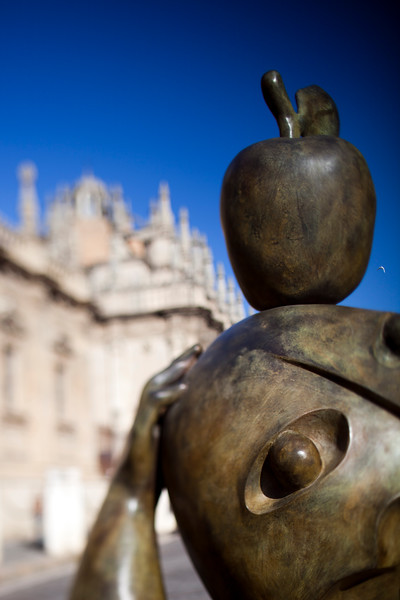 Sculpture by Ripolles exhibited outdoors in front of the Cathedral of Seville, Spain. Tilted lens used for shallower depth of field.