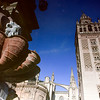 The Giralda Tower reflected on the fountain of Virgen de los Reyes square, Seville, Spain