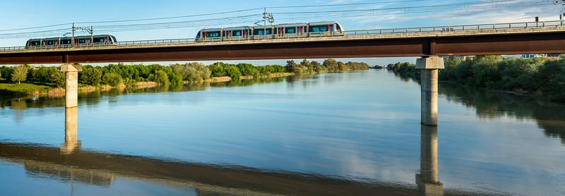 Two Metro de Sevilla (Undeground) trains over the Guadalquivir river, San Juan de Aznalfarache, Seville, Spain.