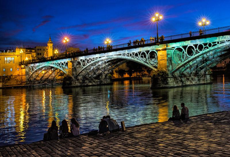 Triana bridge at dusk, Seville, Spain