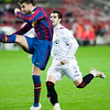 Pique kicking the ball before Negredo. Spanish Cup game between Sevilla FC and FC Barcelona, Ramon Sanchez Pizjuan stadium, Seville, Spain, 13 January 2010