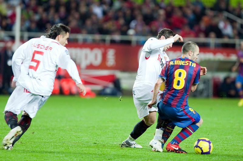 Iniesta trying the dribble Dragutinovic. Spanish Cup game between Sevilla FC and FC Barcelona, Ramon Sanchez Pizjuan stadium, Seville, Spain, 13 January 2010