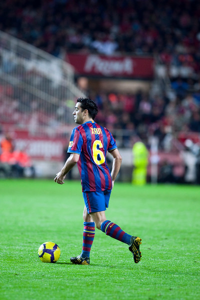 Xavi with the ball. Spanish Cup game between Sevilla FC and FC Barcelona, Ramon Sanchez Pizjuan stadium, Seville, Spain, 13 January 2010