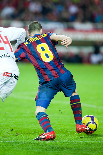 Iniesta with the ball. Spanish Cup game between Sevilla FC and FC Barcelona, Ramon Sanchez Pizjuan stadium, Seville, Spain, 13 January 2010
