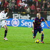 Iniesta with the ball marked by Konko. Spanish Cup game between Sevilla FC and FC Barcelona, Ramon Sanchez Pizjuan stadium, Seville, Spain, 13 January 2010