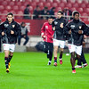 Sevilla FC players warming up under the rain before the Spanish Cup game between Sevilla FC and FC Barcelona, Ramon Sanchez Pizjuan stadium, Seville, Spain, 13 January 2010