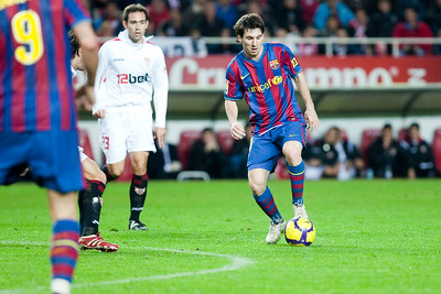Messi with the ball. Spanish Cup game between Sevilla FC and FC Barcelona, Ramon Sanchez Pizjuan stadium, Seville, Spain, 13 January 2010