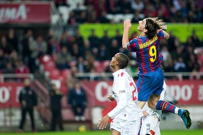 Ibrahimovic jumping. Spanish Cup game between Sevilla FC and FC Barcelona, Ramon Sanchez Pizjuan stadium, Seville, Spain, 13 January 2010