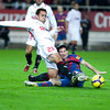 Lolo tries to clear the ball before Messi. Spanish Cup game between Sevilla FC and FC Barcelona, Ramon Sanchez Pizjuan stadium, Seville, Spain, 13 January 2010