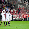Sevilla FC players cheering their fans at the end of the Spanish Cup game between Sevilla FC and FC Barcelona, Ramon Sanchez Pizjuan stadium, Seville, Spain, 13 January 2010