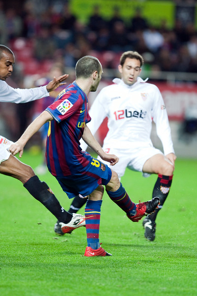 Iniesta centering. Spanish Cup game between Sevilla FC and FC Barcelona, Ramon Sanchez Pizjuan stadium, Seville, Spain, 13 January 2010
