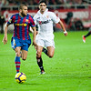 Daniel Alves with the ball pursued by Renato. Spanish Cup game between Sevilla FC and FC Barcelona, Ramon Sanchez Pizjuan stadium, Seville, Spain, 13 January 2010