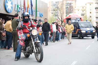 Sevilla FC fan riding a motorcycle
