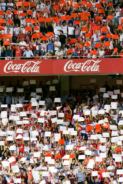 Sevilla FC fans doing a tifo with colored cards. Taken before the Spanish League game between Sevilla FC and Real Madrid, Sanchez Pizjuan Stadium, Seville, Spain, 4 October 2009