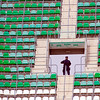 Riot policeman watching the stands for the arrival of Sevilla FC fans to Real Betis stadium before Sevilla's local football derby. Ruiz de Lopera stadium, town of Seville, autonomous community of Andalusia, southern Spain