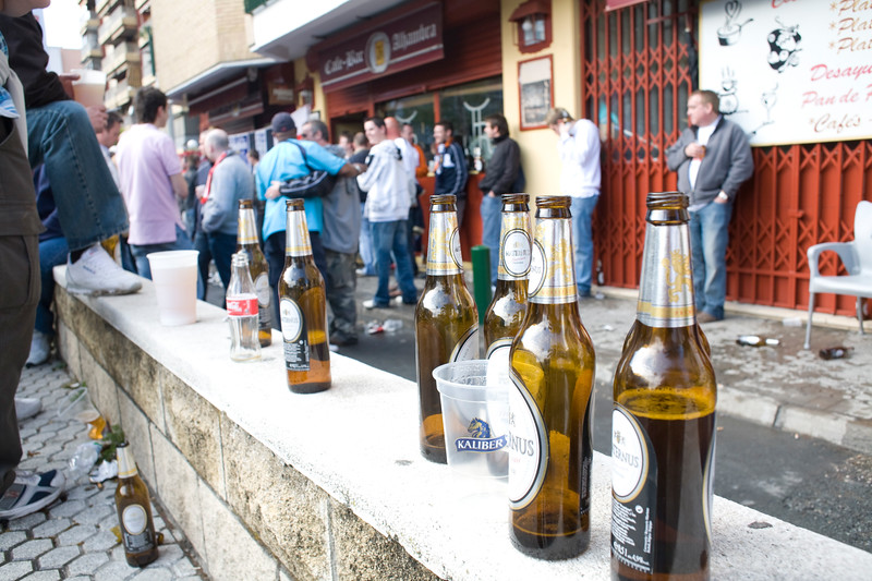 Spurs fans drinking beer on Seville streets