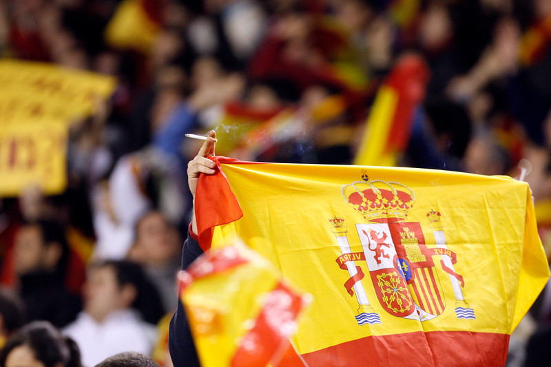 Smoking Spanish flag. Taken during the friendly football game between the national teams of Spain and England that took place in the Sanchez Pizjuan stadium, Seville, Spain, 11 Feb 2009.