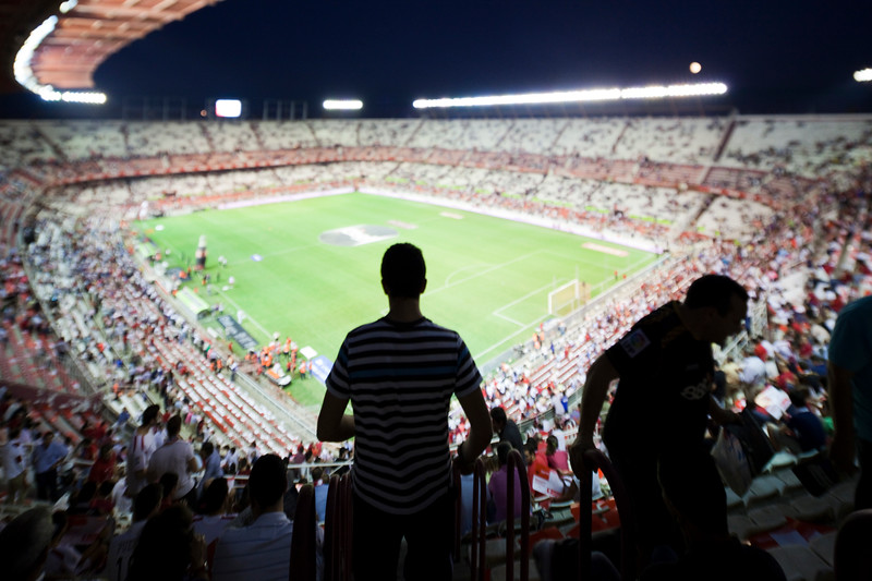 Spectator arriving to their seats. Taken before the Spanish League game between Sevilla FC and Real Madrid, Sanchez Pizjuan Stadium, Seville, Spain, 4 October 2009