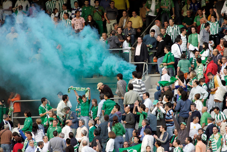 Real Betis fans lighting a flare. Taken before the local derby between Real Betis and Sevilla FC which took place at Ruiz de Lopera stadium, Seville, Spain, on 11 May 2008.