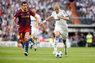 Pepe pursued by Busquets, UEFA Champions League Semifinals game between Real Madrid and FC Barcelona, Bernabeu Stadiumn, Madrid, Spain