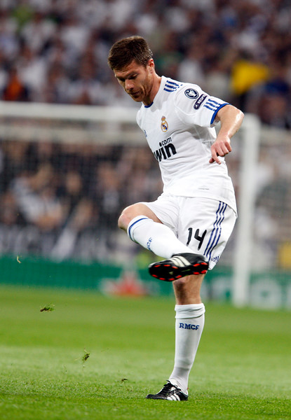 Xabi Alonso kicking the ball, UEFA Champions League Semifinals game between Real Madrid and FC Barcelona, Bernabeu Stadiumn, Madrid, Spain