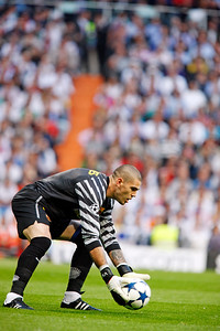 Victor Valdes about to perform a goal kick, UEFA Champions League Semifinals game between Real Madrid and FC Barcelona, Bernabeu Stadiumn, Madrid, Spain