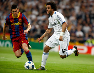 Marcelo controlling the ball pursued by Villa, UEFA Champions League Semifinals game between Real Madrid and FC Barcelona, Bernabeu Stadiumn, Madrid, Spain