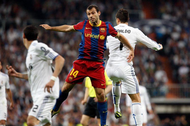 Mascherano and Cristinano Ronaldo jumping, UEFA Champions League Semifinals game between Real Madrid and FC Barcelona, Bernabeu Stadiumn, Madrid, Spain