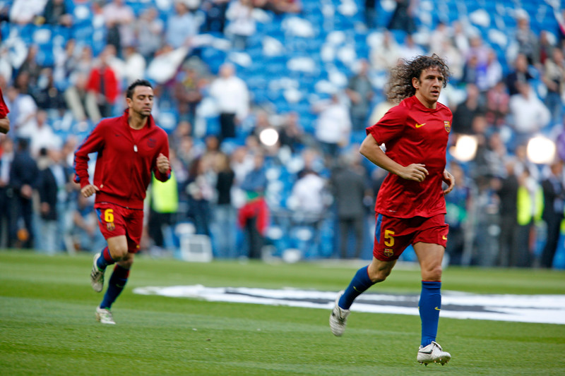 Xavi (left) and Puyol (right) warming up before the UEFA Champions League Semifinals game between Real Madrid and FC Barcelona, Bernabeu Stadiumn, Madrid, Spain