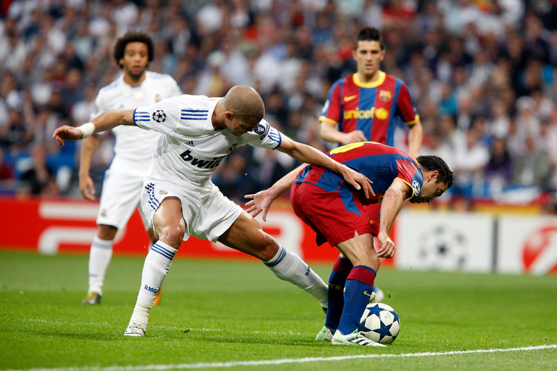Pepe and Xavi fighting for the ball, UEFA Champions League Semifinals game between Real Madrid and FC Barcelona, Bernabeu Stadiumn, Madrid, Spain
