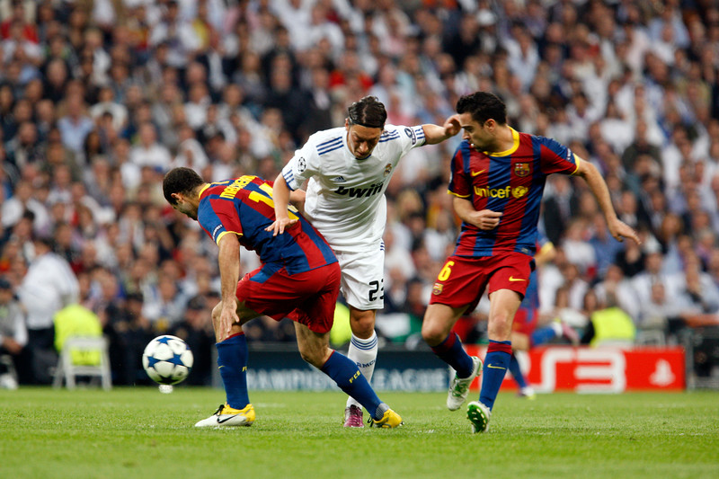 Ozil fighting with Mascherano and Xavi, UEFA Champions League Semifinals game between Real Madrid and FC Barcelona, Bernabeu Stadiumn, Madrid, Spain
