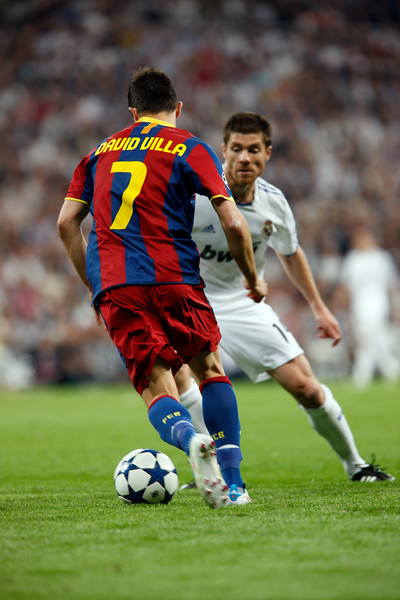 Villa trying to dribble past Xabi Alonso, UEFA Champions League Semifinals game between Real Madrid and FC Barcelona, Bernabeu Stadiumn, Madrid, Spain