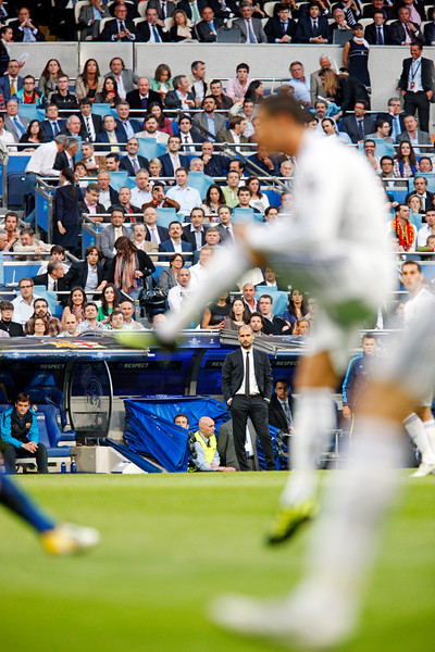 Guardiola looking at the game, UEFA Champions League Semifinals game between Real Madrid and FC Barcelona, Bernabeu Stadiumn, Madrid, Spain