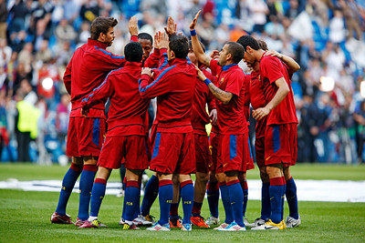 FC Barcelona players hugging before the UEFA Champions League Semifinals game between Real Madrid and FC Barcelona, Bernabeu Stadiumn, Madrid, Spain