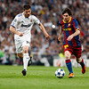 Messi with the ball marked by Xabi Alonso and Sergio Ramos, UEFA Champions League Semifinals game between Real Madrid and FC Barcelona, Bernabeu Stadiumn, Madrid, Spain