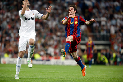 Messi and Arbeloa trying to head the ball, UEFA Champions League Semifinals game between Real Madrid and FC Barcelona, Bernabeu Stadiumn, Madrid, Spain