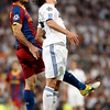 Mascherano and Ozil jumping, UEFA Champions League Semifinals game between Real Madrid and FC Barcelona, Bernabeu Stadiumn, Madrid, Spain